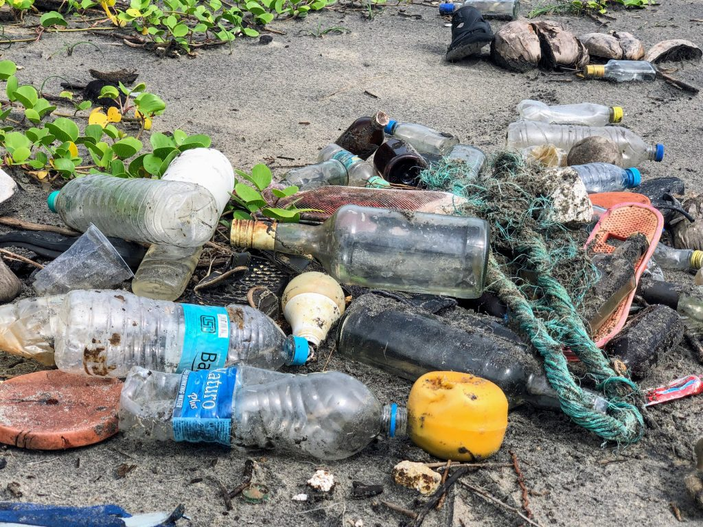plastic containers of water on beach