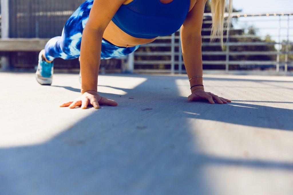 Girl doing push ups outdoors