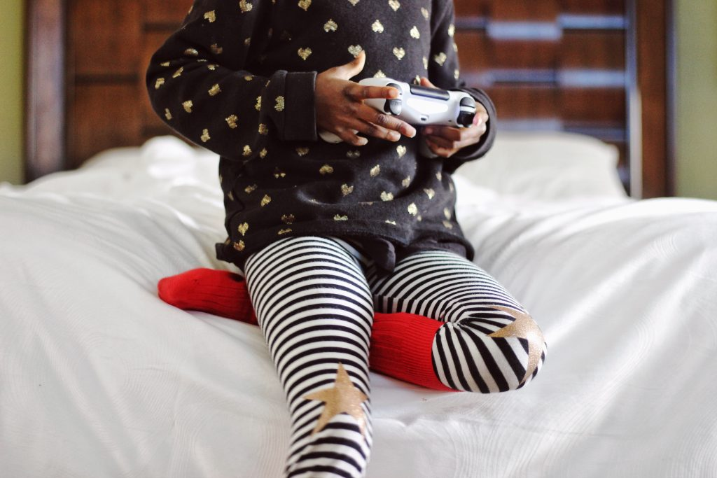 Child holding gaming controller